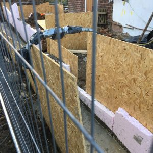 Concrete footings and clay board